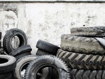 Pile of old tire for recycle. Pile of old tire on cement background for recycle stock photography