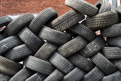 Pile of old tires. Photo of pile of old tires stock photo