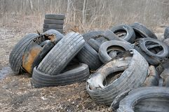 Pile of old tires and wheels for rubber recycling. stock photos