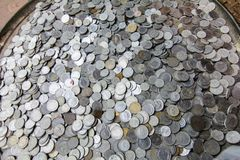 Pile of old turkish black and white coins stock photos