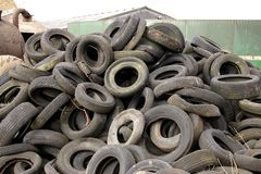 Pile of old tyres. A large pile of old tyres in a farm yard. The rubber is decaying and worn stock images