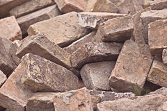 Pile of Old Used Bricks as Construction Material Stock Photos