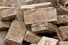 Pile of Old Used Bricks as Construction Material Stock Photo