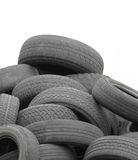 Pile of old used tires isolated Stock Photos