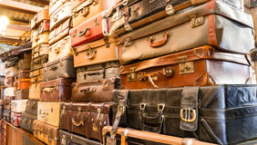 Pile of old vintage bag suitcases. In room Stock Photography