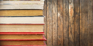 Pile of old vintage books, wooden planks Royalty Free Stock Image