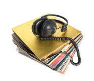 Pile of old vinyl records and vintage headphones isolated. Stock Images