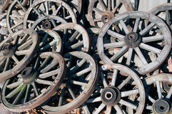 Pile of old wagon wheels Stock Image
