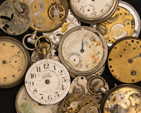 Pile of old watches. Pile of old broken pocket watches Stock Photo