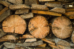 A pile of old wood for the stove. Textured background.  Stock Photography
