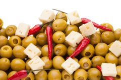 Pile of olives and chili pepper and sheep cheese Stock Image