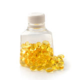 Pile of omega 3 fish oil capsules spilling out of a bottle Stock Images