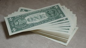 Pile of One Dollar Bills Cash. A shot of a pile of fanned out One Dollar Bills Stock Photos