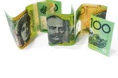 One hundred Australian dollar banknotes isolated on white backgr. Pile of one hundred Australian dollar banknotes isolated on white background Stock Photo