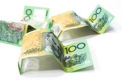 One hundred Australian dollar banknotes  on white backgr. Pile of one hundred Australian dollar banknotes  on white background Royalty Free Stock Photography