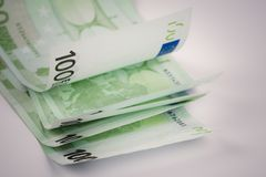 Pile of one hundred euro banknotes  on white background. Stack of hundred Euro bills use for money background and financial concepts Royalty Free Stock Photos