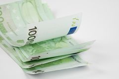 Pile of one hundred euro banknotes  on white background. Stack of hundred Euro bills use for money background and financial concepts Stock Photos