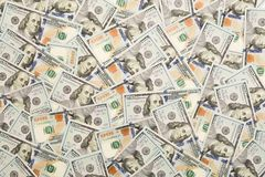 A pile of one hundred US banknotes with president portraits. Cash of hundred dollar bills, dollar background image with high stock photo