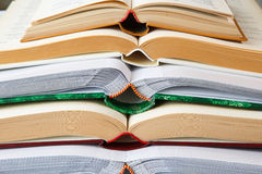 Pile of open books Stock Images