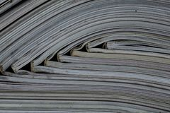 Pile of open magazines without texts seen from the side.  royalty free stock photography