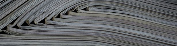 Pile of open magazines without texts seen from the side royalty free stock photo
