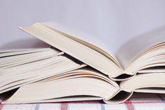 Pile of the opened books. On a table royalty free stock image