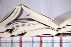 Pile of the opened books. On a table royalty free stock photos