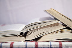 Pile of the opened books. On a table royalty free stock photo