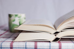 Pile of the opened books. On a table stock image
