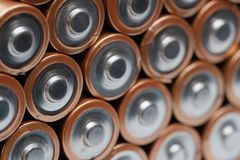 Pile of orange batteries stacked stock photo