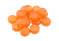 Pile of orange boiled sweets Royalty Free Stock Images