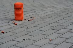 Pile of orange clay pigeon targets and shards of shot pigeon on pavement Royalty Free Stock Photos