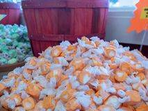 Pile of orange flavor taffy candy on sale in candy shop royalty free stock photography