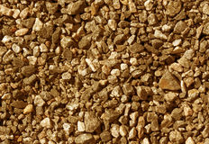 Pile of orange toned gravel stones. Royalty Free Stock Photos