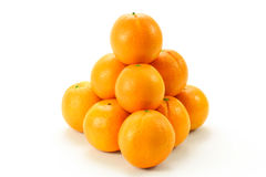 Pile of oranges. A pyramid-formed pile of oranges on white Royalty Free Stock Image