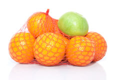The pile of oranges and apple Royalty Free Stock Image