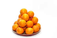 Pile of oranges. On a plate Stock Images