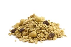 Pile of Organic Cereal. Side view of a pile of organic cereal on white background. With hazelnuts royalty free stock images
