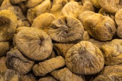 Pile of organic dry figs on the market shelf. Close up shot of sun dried figs grown in Turkey on the market shelf Royalty Free Stock Images