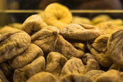 Pile of organic dry figs on the market shelf. Close up shot of sun dried figs grown in Turkey on the market shelf Royalty Free Stock Photos