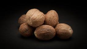 Pile of Organic Nutmeg Seed (Myristica fragrans) Stock Photography