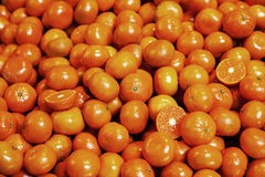 Pile of organic tangerines at market stall Royalty Free Stock Photo