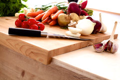 Pile of organic vegetables on a rustic wooden. Table Stock Photos