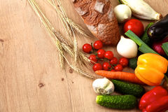 Pile of organic vegetables on a rustic wooden Stock Photo