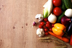 Pile of organic vegetables on a rustic wooden. Table Stock Image