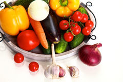 Pile of organic vegetables on a rustic wooden table Stock Image