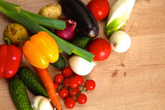 Pile of organic vegetables on a rustic wooden table Royalty Free Stock Photo