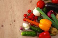 Pile of organic vegetables on a wooden table Stock Images