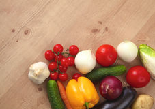Pile of organic vegetables on a wooden table Royalty Free Stock Images