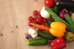 Pile of organic vegetables on a wooden table Stock Image